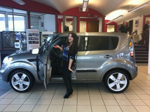 Katie with her Kia Soul. Contributed