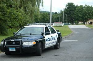 School resource officer, Madelyn Farfan, parked her cruiser along the entrance of Torrington High School on Friday, only allowing students, staff and parents into the high school after police learned of a threat that was spreading among students. Bruno Matarazzo Jr. Republican-American
