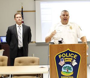 Naugatuck Police Lieutenant Bryan Cammrata addresses the press during a press conference at the police department in Naugatuck Tuesday morning. School buses in the borough will be equipped with cameras to catch offenders who illegally pass stopped school buses. Christopher Massa Republican-American