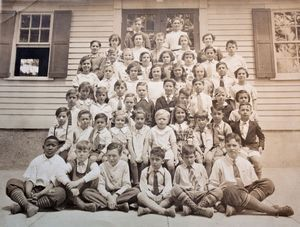A newspaper clipping of students outside the building of what use to be East Mountain School in Waterbury which is now Employers Reference Source, Inc. Darlene Douty Republican American