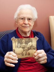 Violet Codianni, of Waterbury holds up a newspaper clipping of her graduating class of 1939 inside the building of what use to be East Mountain School in Waterbury which is now Employers Reference Source, Inc.Darlene Douty Republican American