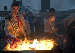 Jim Shannon Republican-American Joseph Guinazzo, 17, a member of Boy Scout Troop 21, places American flags into the fire on Sunday as part of a flag retirement ceremony he organized for his Eagle Scout project. Giunazzo and fellow scouts collected nearly 4,000 retired flags.