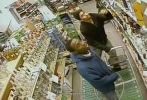 This surveillance photo from 2011 depicts two men who police said later tried to rob a Watertown couple using a handgun Dec. 6, 2011. Police arrested the man in the foreground, David Davis, after extraditing him from New York Wednesday. The other man is still at large.