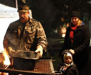 Bethlehem, CT-07 December 2012-120712CM05- Clayton Gustafson, with the Bethlehem Lions Club, roasts chestnuts on an open fire with his daughter Amy Gustafson and her step-son, Collin Wilcox, 3, both of New Britain, during the 32nd annual Christmas Town Festival Friday night in Bethlehem. The event featured vendors, the lighting of the Christmas tree, music, sleigh rides and other activities. The festival continues Saturday from 10 a.m until 4 p.m. Christopher Massa Republican-American