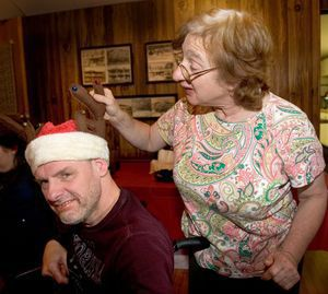 Lois Mackler of Wolcott checks out Billy Weymer´s, of Wolcott, reindeer Santa hat at a Christmas party in Wolcott Saturday. The Wolcott Landowners Protective Association held its annual Christmas party for residents with special needs.  Steven Valenti Republican-American