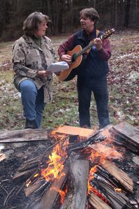 Gerri Griswold, director of development and administration at the White Memorial Conservation Center in Litchfield, and Tom Alena of Harwinton, led a fireside Christmas carol sing on Saturday at the center's Kleinholz Fire Pit. About 20 people turned out to sing and enjoy refreshments afterward. John McKenna Photo