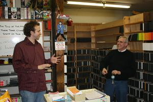 WOODBURY, CT - 13 Dec 2013 - 121313RHHO01 - Filmmaker Ben Churchill, left, talks to Video World owner Ed Kaczynski, right, during the filming of a documentary on the store's last days in 2010 in Woodbury. Contributed