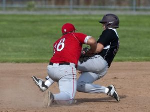 TORRINGTON, CT--060315JS06- Torrington's Timothy Latosek (5) is tagged out by Pomperaug's Jacob Parsell (16) as he tries to advance to third base during their CIAC Class L first-round game Wednesday at Fuessenich Park in Torrington.   Jim Shannon Republican-American
