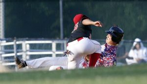 Waterbury, CT- 30 June 2015-063015CM11- Waterbury's Justin Rodriguez tags out Oakvilles Grant Wallace as he attempts to pick up an extra base at third, during their American Legion baseball matchup at Municipal Stadium in Waterbury on Tuesday. Waterbury won, 1-0. Christopher Massa Republican-American