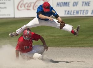 MIDDLETOWN, CT--- -072515JS12--Waterbury's Brendan Bessette (15) breaks up a double-play attempt by Monroe's Kyle Horton (6) during their American Legion state tournament game Saturday at Palmer Field in Middletown.  Jim Shannon Republican-American