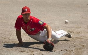 MIDDLETOWN, CT--- -072515JS07--Waterbury's third baseman Nelson Merced (13) dives for the ball and knocks it down during their American Legion state tournament game against Monroe Saturday at Palmer Field in Middletown.  Jim Shannon Republican-American