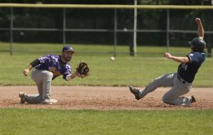 TORRINGTON, CT--- -080215JS21--Naugatuck's Ryan Russell (24) safely steals second base in front of the tag by Tri-Town's Devin Murphy (2) during the Stan Musial championship game at Fuessenich Park in Torrington on Sunday. Naugatuck defeated Tri-Town 6-1.  Jim Shannon Republican-American