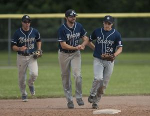 TORRINGTON, CT--- -080215JS23--Naugatuck's Mack Cianciolo (28), Jeff Sturm (15) and Ryan Russell (24) celebrate their 6-1 win over Tri-Town Trojans to capture during the Stan Musial championships at Fuessenich Park in Torrington on Sunday. Jim Shannon Republican-American