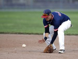 Torrington, CT- 20 August 2015-082015CM06- Litchfield Cowboys' Brian Hungerford scoops up a grounder against Tri-Town during the finals of the Tri-State League championship at Fussenich Park in Torrington on Thursday. Christopher Massa Republican-American
