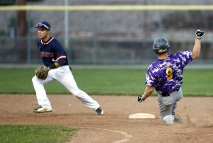 Torrington, CT- 20 August 2015-082015CM08- Litchfield Cowboys' Bryan Failla waits for the throw as Tri-Town's James Cramphin safely steals second base during the finals of the Tri-State League championship at Fussenich Park in Torrington on Thursday. Christopher Massa Republican-American