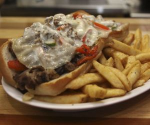 A Philly cheesesteak with peppers, onions and provolone cheese is on the sandwich menu at the Cardinal Grill and Como Bakery II in Morris. Credit: John McKenna