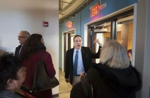 Project Manager Andrew Martelli, with the Waterbury Development Corp., answers questions as he leads a tour of the Rectory Building after a dedication and ribbon-cutting ceremony in Waterbury on Tuesday. The building will house a Starbucks on the first floor, and UConn classrooms and offices on the upper floors. Jim Shannon Republican-American