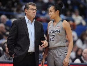 Connecticut coach Geno Auriemma, left, talks with Saniya Chong during the second half of the team's NCAA college basketball game against UCF, Wednesday, Jan. 20, 2016, in Hartford, Conn. UConn won 106-51. (AP Photo/Jessica Hill)