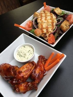 Garden salad with chicken and honey BBQ wings offer something for everyone at Gomers Bar & Grill. Credit: Michele Morcey