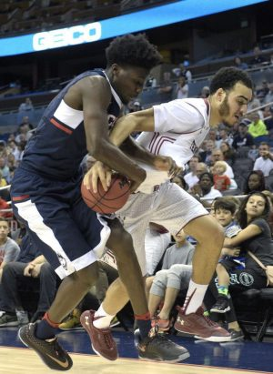 Connecticut guard Daniel Hamilton, left, wrestles the ball away from Temple forward Obi Enechionyia (0) during the second half of an NCAA college basketball game in the semifinals of the American Athletic Conference men's tournament in Orlando, Fla., Saturday, March 12, 2016. Connecticut won 77-62. (AP Photo/Phelan M. Ebenhack)