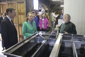 Lou Berecz of The Farm in Woodbury talks with Sen. Christopher S. Murphy and U.S. Rep. Elizabeth H. Esty during their visit to the Sugar Shack on Friday. John Nestor Republican-American