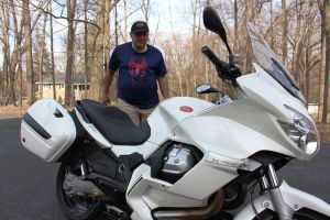 Jim Botsolis of 50 Mobile Transport admires the 2011 Moto Guzzi Norge GT 8V that he has just delivered to the RIDE-CT stable. Bud Wilkinson / Republican-American