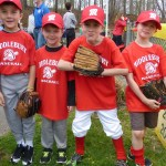 The Red Team, also known as RBC Bearings, is ready for baseball during the opening ceremony of Middlebury Baseball on Saturday at Quassy Field. From the left are Harrison Canniff, Billy Dunn, Zayden Woodhouse, and Logan Merritt. (Palladino/RA)