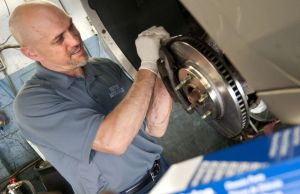 Louis Codianna, service manager at Union Auto Sales & Service works on brakes in the shop on Congress Avenue in Waterbury Wednesday. The shop offered free repairs for needy customers for the 100th anniversary of the founding of ACDelco. Alec Johnson /Republican-American