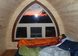 Pod Sunrise: My sweetheart Marilyn slept on happily as I snapped this photo of the sunrise from a comfortable þÄúPodþÄù cabin at Au Diable Vert in QuebecþÄôs eastern Townships. (Tim Jones/EasternSlopes.com photo)