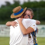 Seymour Pitching coach Neil Swanchak gives a congratulatory hug to Raeanne Geffert following their 1-0 win over Rocky Hill to capture the Class M state championship  Friday at DeLuca Field in Stratford.   Jim Shannon Republican-American