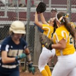 Holy Cross' Lindsay Barton (14) catches a pop up in foul territory that started a triple-play during their Class S state championship game against Notre Dame-Fairfield Saturday at DeLuca Field in Stratford.   Jim Shannon Republican-American