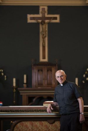 WATERBURY, CT- 31 May 2016-053116EC02- Father Paul Pace has been with St. Francis Xavier Church in Waterbury for 35 years. The Waterbury-born priest has been practicing for 50 years total. Erin Covey Republican-American