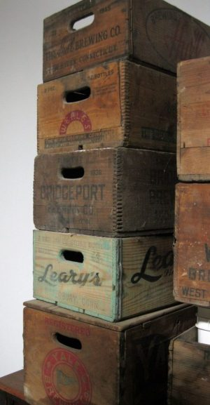 01_FEA_060116WS04 – A collection of vintage Connecticut brewery delivery boxes, owned by Jeff Browning, partner and head brewer at the soon-to-open BrewPort Brewing in Bridgeport. Will Siss Republican-American