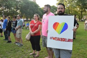 Kevin Caban, 31, of Waterbury, proudly holds his homemade sign to show his support for the Orlando shooting victims. Jacqueline Stoughton Republican-American