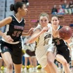 Thomaston's Morgan Sanson (14) drives to the basket on Canton's Sarah Bowman (32) during their Class S state championship game Saturday at Mohegan Sun Arena.  Jim Shannon Republican-American