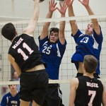 Lewis Mills' (25) Thomas DiSorbo and (23) Benjamin Lewis block a spike from Masuk's Cole Engle in the quarterfinals of the Class M tournament in Burlington Friday night. Erin Covey Republican-American