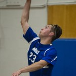 Lewis Mills' Benjamin Lewis serves the ball to Masuk in the quarterfinals of the Class M tournament in Burlington Friday night. Erin Covey Republican-American