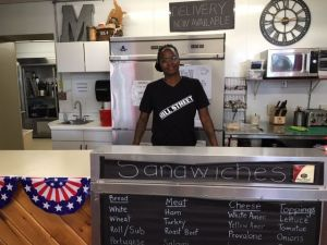 Rochina Brown owns Mill Street Deli in the south end of Waterbury. Michele Morcey
