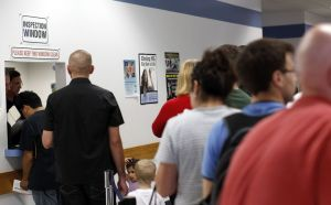 Customers wait in line at the Inspection Window inside the Department of Motor Vehicles in Waterbury in 2011. The DMV is reviewing its procedures to improve customer satisfaction. Republican-American archives