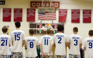 WEST HARTFORD, CT- 08 JUNE 2007- 060807JT17- Lewis Mills during the national anthem before the Class M volleyball state finals against Enfield at Conard High School in West Hartford on Friday. The Spartans won 3-0. Josalee Thrift Republican-American