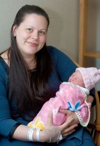 Ursa Mooney of Shelton and her new baby girl at Griffin Hospital in Derby Friday.  Steven Valenti Republican-American