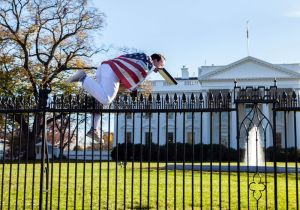 In this photo provided by Vanessa Pena, a man jumps a fence at the White House on Thursday, Nov. 26, 2015, in Washington. The man was immediately apprehended and arrested pending criminal charges, the Secret Service said. President Barack Obama and his wife and daughters were spending Thanksgiving the holiday at the White House. (Vanessa Pena via AP) MANDATORY CREDIT