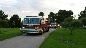 MIDDLEBURY, CT -- 06 Aug. 2014: 080614BB02 --- Fire trucks head up a driveway to the Smith family's cistern on Tranquility Road. Bill Bittar Republican-American