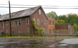 Winsted's selectmen will put the former Lambert Kay pet food supply company at 32 Lake St. back on the market after figuring out how much it will cost to clean up the site.  Republican-American archives