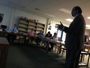 Gregory Dandio, president and CEO of Trifection Group, presents the findings of an analysis of the Region 14 school district's Internet filtration system to the Board of Education at Nonnewaug High School in Woodbury. Rick Harrison / Republican-American