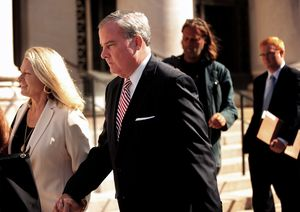 Former Connecticut Gov. John Rowland and his wife Patty Rowland exit federal court, Wednesday in New Haven. A Republican running for Congress testified Wednesday that former Connecticut Gov. John G. Rowland proposed becoming a consultant to his 2010 campaign while being paid as though he was working for the candidate's animal rescue organization. (AP Photo/The Connecticut Post, Brian A. Pounds)