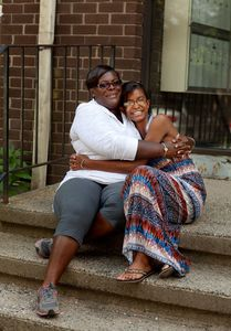 WATERBURY, CT-18 August 2014-081814BF02- LaTeena Bartee, 26, right, poses for a portrait with her mother Angela Holmes. Bartee started a program called Young Civic Learners in 2011 which instructs kids on the law, civics and citizenship. It is a volunteer program to initiate middle school students into the workings of government. Bob Falcetti Republican-American