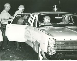 A man is led into a police car after a violent uprising in North Square in 1967. Republican-American archive