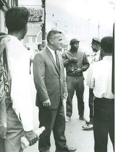 Mayor Frederick Palomba, second from left, meets with North Square residents after a violent uprising there in 1967. Republican-American archive