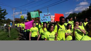 Hundreds of Naugatuck Valley Community College students joined school and city leaders Wednesday for a march along Chase Parkway highlighting the need for a sidewalk near the college.  jim shannon republican-american